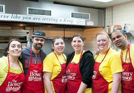 Volunteer groups help serve meals at The Bowery Mission