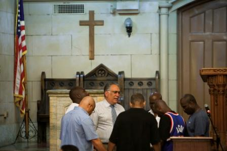 Praying in The Bowery Mission Chapel