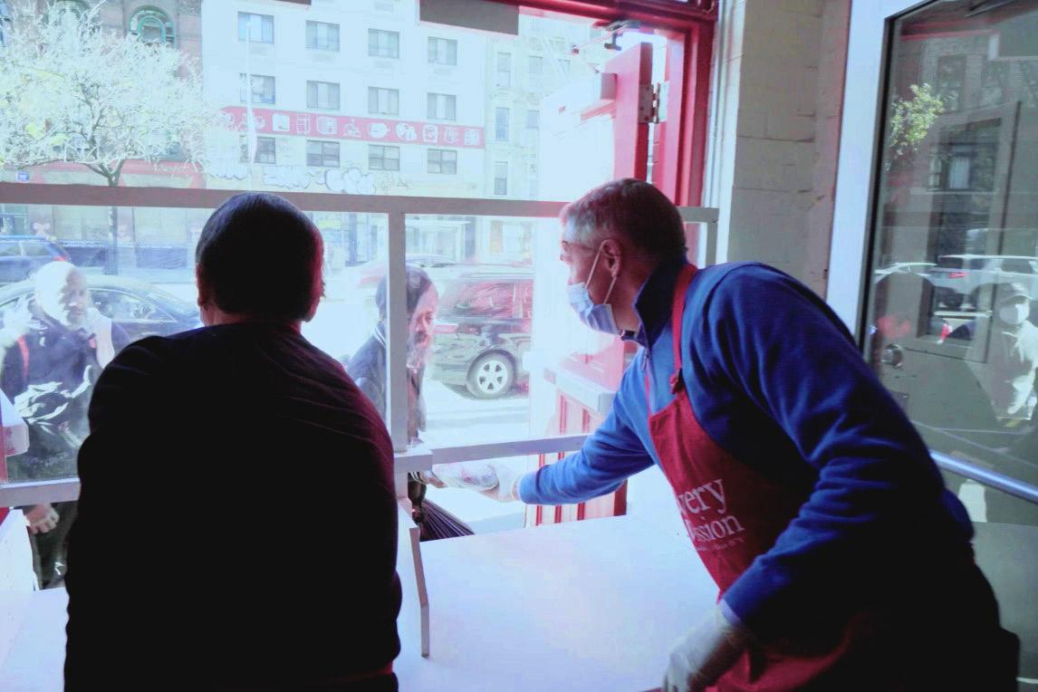 Volunteers serving meals